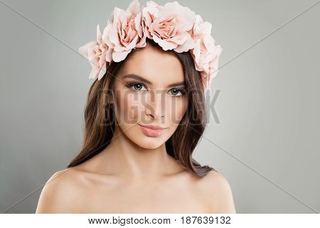 Perfect Girl with Pink Flowers and Fresh Spring Makeup. Young Face