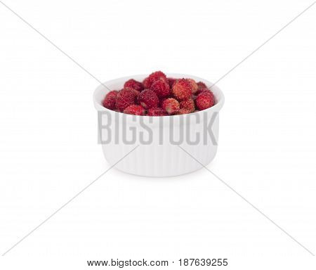 Wild small strawberries in a bowl. Ripe and tasty strawberries isolated on white background. Sweet and juicy berry with copy space for text.