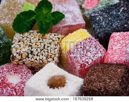 Turkish delight close up. Turkish deligh set. Assorted traditional turkish delight as background