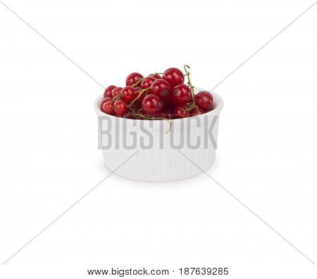 Bowl with redcurrants isolated on white background. Ripe currants close-up. Background berry. Sweet and juicy berry with copy space for text.