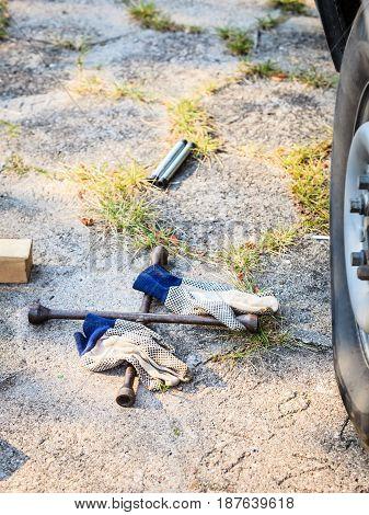 Socket Wheel Wrench And Jack Lying On Ground