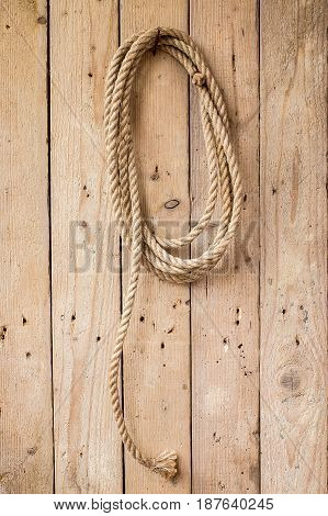 Brown string hanging on wooden wall of a house