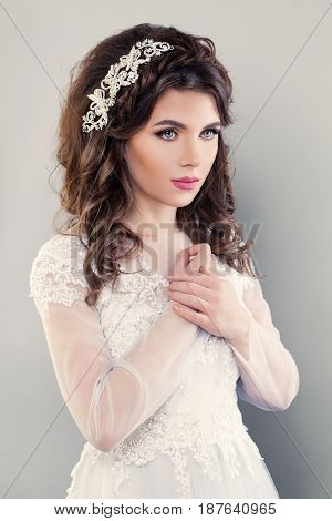 Nice Fiancee Girl Fashion Model. Portrait of Bride in White Dress. Wedding Makeup and Hair style