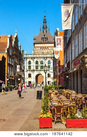 GDANSK POLAND - MAY 19 2017: Street scene with peoples walk on Long Lane in Gdansk. Old Town in Gdansk is a tourist attraction for visitors.