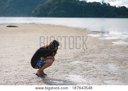 Asia Woman Wearing Black Shirt She Sitting And Looking Moist Sand Beach On Her Front. Have Sea And I