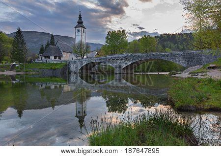 Church of Sv. John the Baptist and a bridge by the Bohinj lake Triglav National Park Slovenia