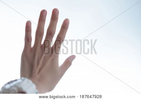 close up. hand of young woman wearing white watch have white are background. this image for peoplebody part and background concept