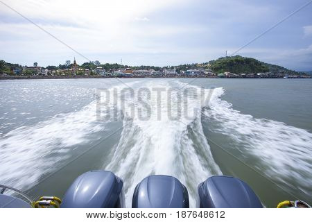 KAW THAUNG MYANMAR - MAY7 : rear view of speed boat departure from kaw thaung or formerly name of victoria point important southern port of myanmar border of ranong province southern of thailand on may 72017 kaw thaung myanmar