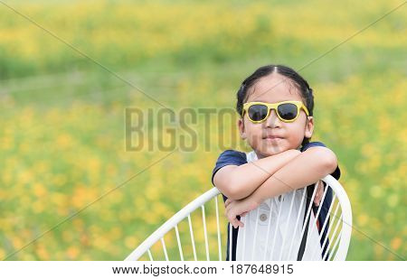 cute girl and yellow flower background travel concept
