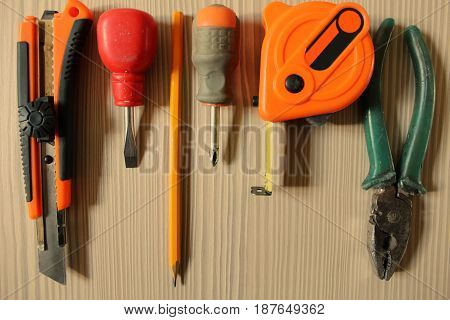 Working tools on wooden background. The manufacture of furniture