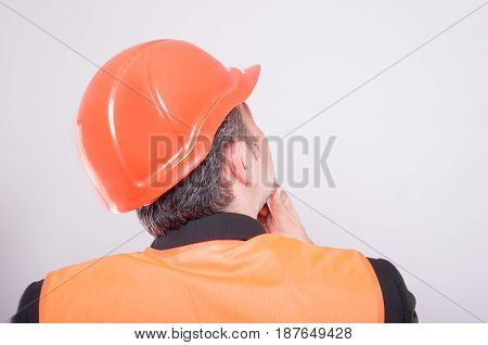 Back View Of Engineer Making Thinking Gesture