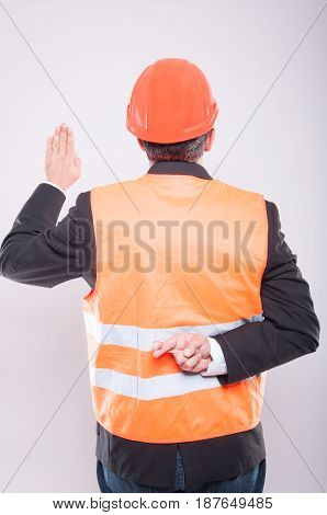 Back View Of Engineer Making Fake Oath Gesture