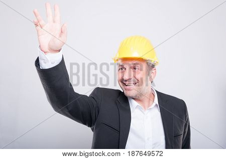 Portrait Of Foreman Making Hay Or Hello Gesture