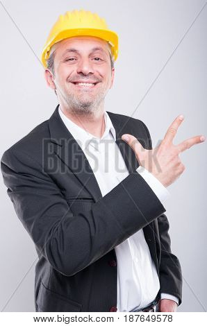 Portrait Of Handsome Engineer Showing Number Three Gesture