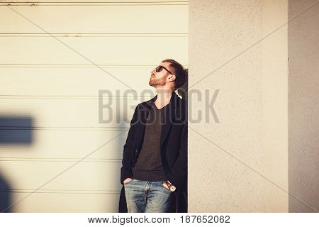 Portrait of a man in a coat and jeans. Copy space