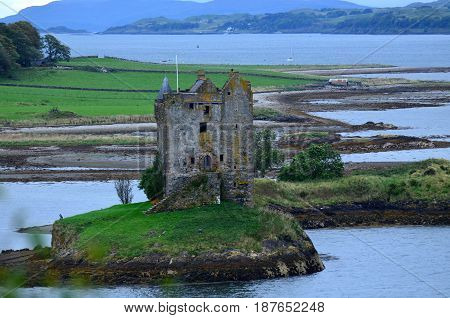 Views of Castle Stalker ruins in Loch Linnhe.