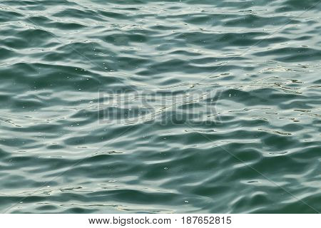 ripples on a gentle swell of the sea surface to be used as a background