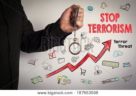 Stop terrorism concept. Red Arrow and Icons Around. Man holding chain clock on white background.