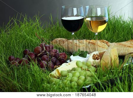 Cheese Platter And Wine With Different Cheese And Grapes
