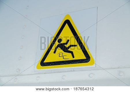 warning sign, caution wet floor at white wall