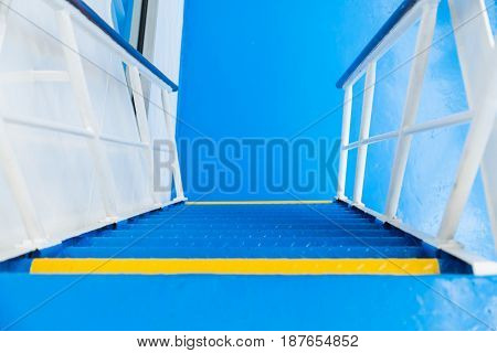 Blue and yellow cruise ship stairs, daylight