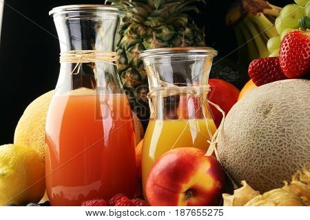 Apple And Orange Juice -several Bottles With Fruit And Berry Juices, Vintage Wooden Background, Sele