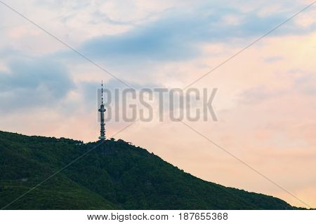 Broadcasting tower on a mountain top viewed at sunset in Sofia Bulgaria in a communications concept. Vitosha mountain
