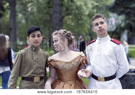 NIZHNY NOVGOROD, RUSSIA  May 20, 2017: Night of museums festival. Young boys and girl photographed in the costume of the early 20th century in the Russian Museum. NIZHNY NOVGOROD