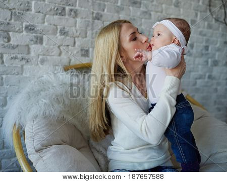 photo of happy mother with cute baby