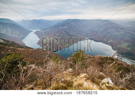 View from Tara mountain in Serbia, Europe. Drina river and hydro power plant in the distance.