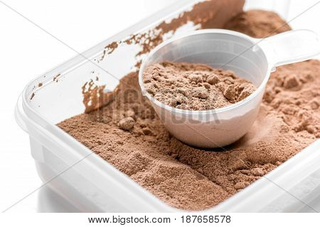 Whey protein powder for fitness nutrition to start training on white background
