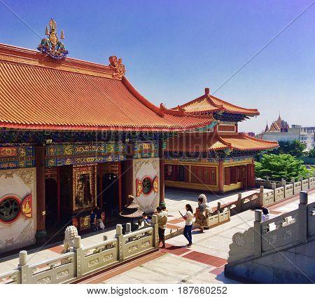 Tourists Visit Traditional Chinese Buddhist Temple or Monastery in Thailand. Wat Borom Raja Kanjanapisek (Wat Leng Neur Yee 2)