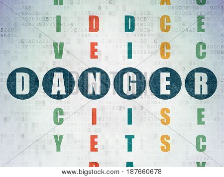 Protection concept: Painted blue word Danger in solving Crossword Puzzle on Digital Data Paper background