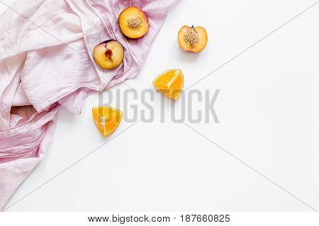 orange and peach summer sweet dessert on fabric white desk background top view mock-up