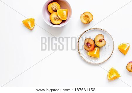 woman summer breackfast with orange and peach fruits on white desk background flat lay mockup