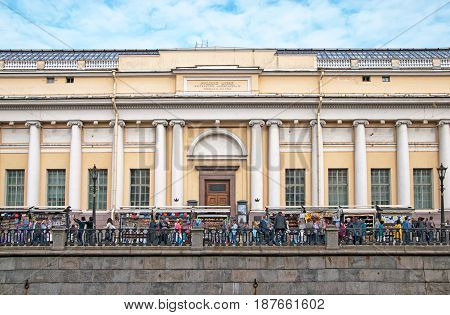 SAINT - PETERSBURG, RUSSIA - MAY 18, 2017: People near open air souvenir shops next to The Russian Museum on Griboyedov Channel Embankment
