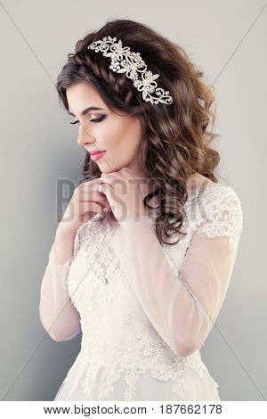 Fashion Portrait of Pretty Woman Fiancee wearing White Evening Gown. Beautiful Model Bride with Hairstyle and Makeup