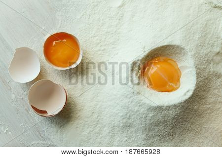 Preparation of ingredients for baking. View from above. Ingredients for baking. (Eggs flour)