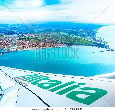 FIUMICINO ITALY - NOVEMBER 13 2016: View of the bay from the Alitalia aircraft with logo on the wing. This company is an italian flag carrier.