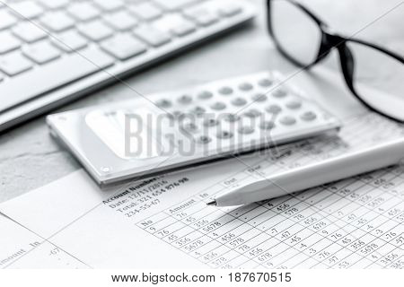 accounting work space with calculator, profit and tables on stone desk background close up