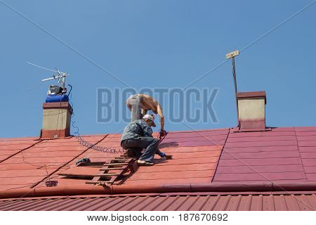 Services Painting Roof assistance for seniors on the roof painting men