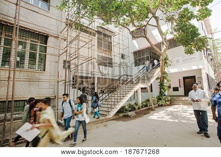 BANGALORE, INDIA - FEB 14, 2017: Students walk around the building of College of Fine Arts on February 14, 2017. With population 8.52 million Bangalore is the third most populous indian city