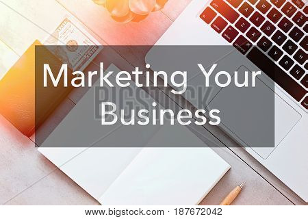 Marketing Your Business text. Freelancer blogger entepreneur businessman working place background.