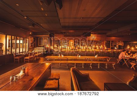 BANGALORE, INDIA - FEB 14, 2017: Visitors of Arbor Brewing Company restaurant having rest with drinks on February 14, 2017. With population 8.52 million Bangalore is the third most populous indian city