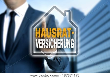 Hausratversicherung (in German Household Insurance) Touchscreen Is Operated By A Businessman