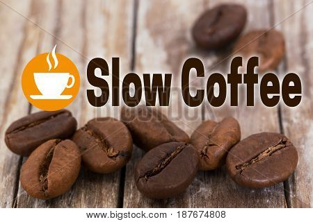 Slow Coffee Concept Background with coffee beans and wood.