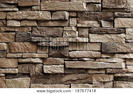 Background Pattern Horizontal Brown Asymmetrical Stone Wall Background or Texture.