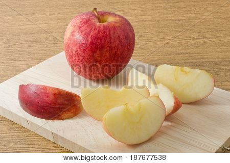 Fresh Fruits Ripe and Sweet Red Apple on A Wooden Cutting Board.