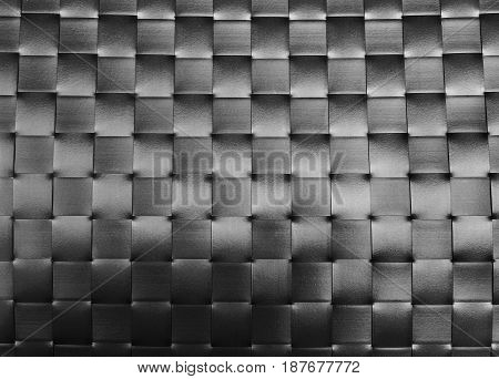 Background Pattern Black Plastic Weave Texture Wicker Surface of Plate Mat.