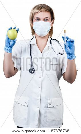 Female doctor with green apple and syringe. Healthy eating concept. Natural vitamins.